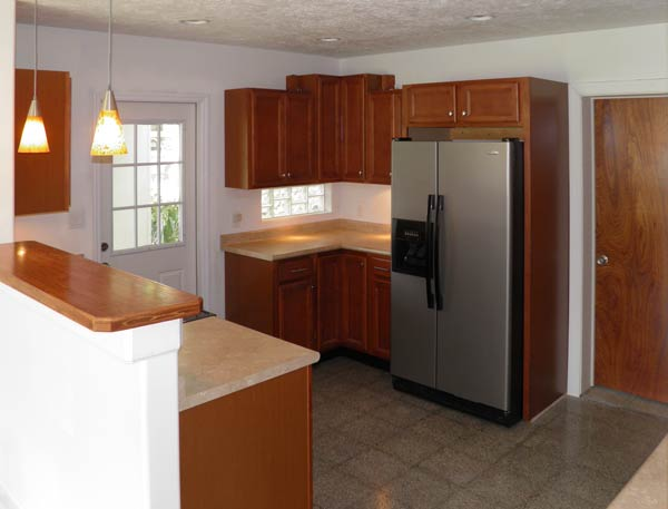 Completely remodeled kitchen opens onto carport.
