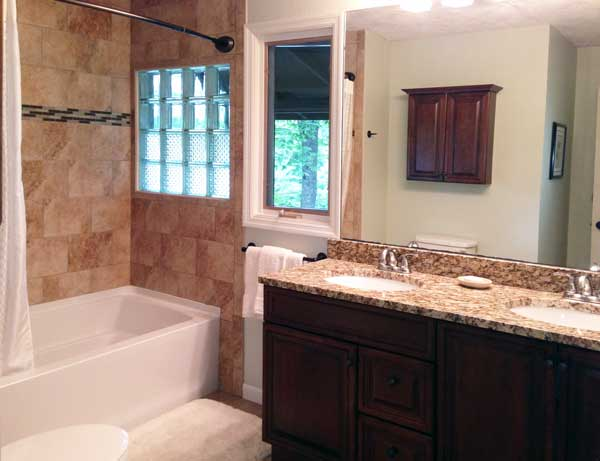 New Master bath with double sink granite vanity, glass block and tile throughout