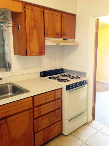 Kitchen opens opens onto large laundry room with lots of additional storage space. Laundry room size: 9' x 8.75'.
